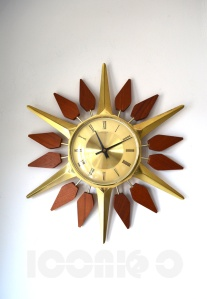 __Anstey Wilson flower sunburst wall clock
