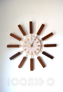 __Manley resin light face sunburst wall clock